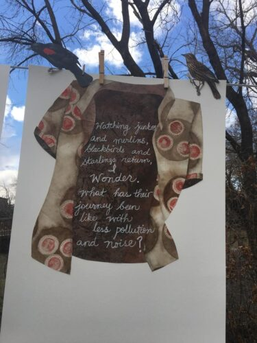 Haiku poem about bird migration during a pandemic, printed on a collage of a shirt with COVID19 virus print.
